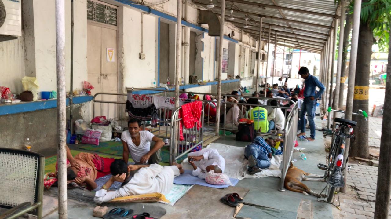 Relatives sleep outside a hospital in Delhi