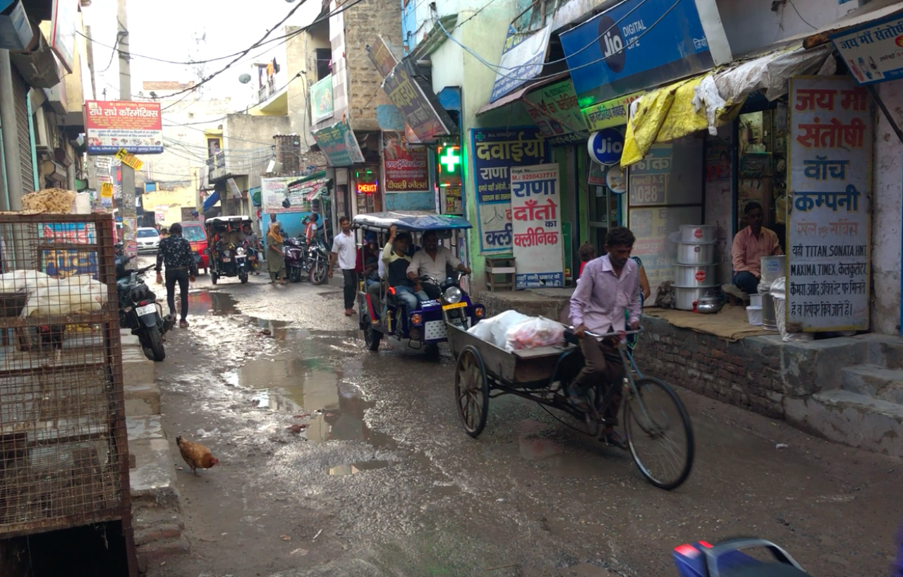 A busy road in a Delhi slum