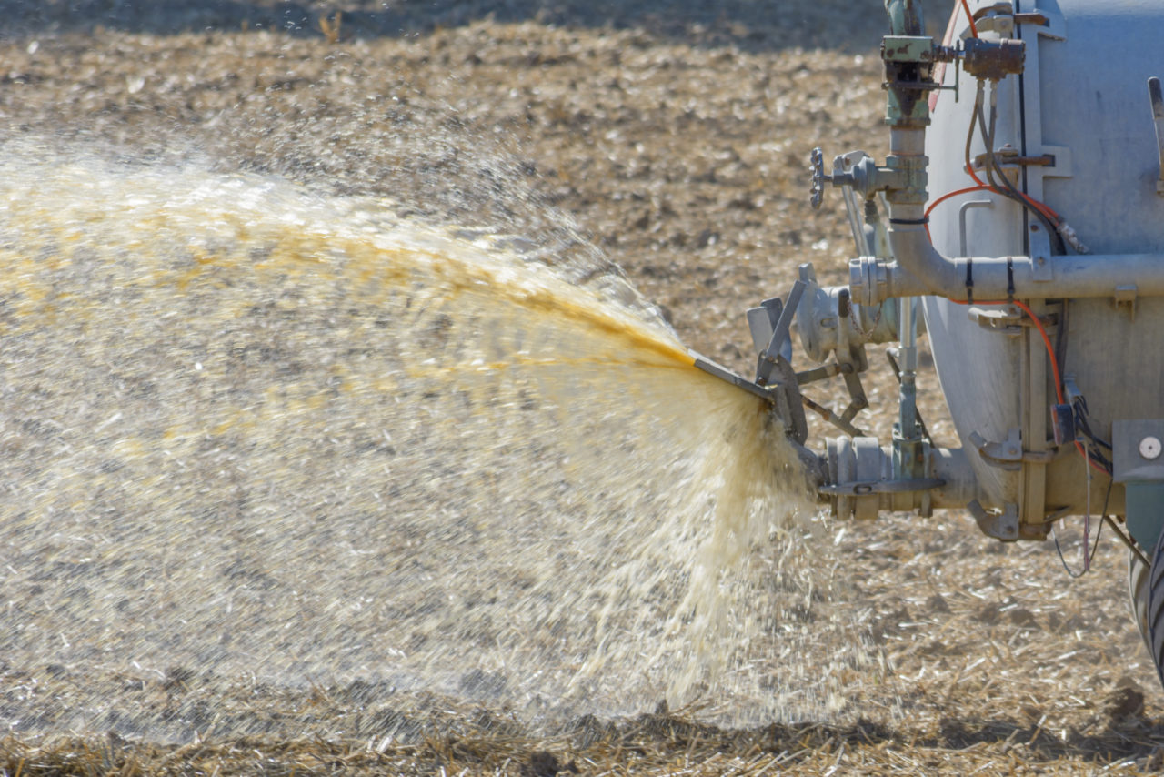 Tractor spraying slurry