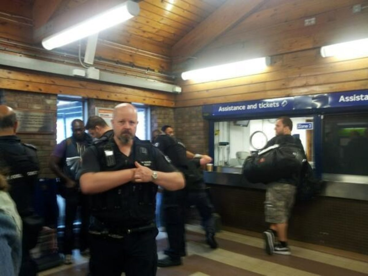 An image of an immigration raid at a London tube station